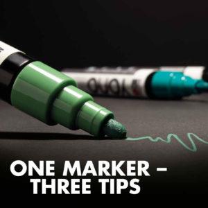 Marabu Yono Marker in verschiedenen Grüntönen zeichnen auf einem schwarzen Papier