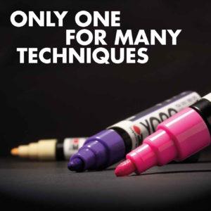 Marabu Yono Marker in Pink, Violett und Gelb bereit zum Malen auf einem schwarzen Papier